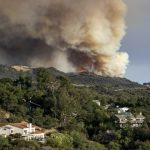 Suspected arsonist sought in LA County wildland fire threatening homes