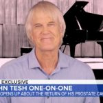 John Tesh reveals he is cancer-free again after his illness returned during the pandemic